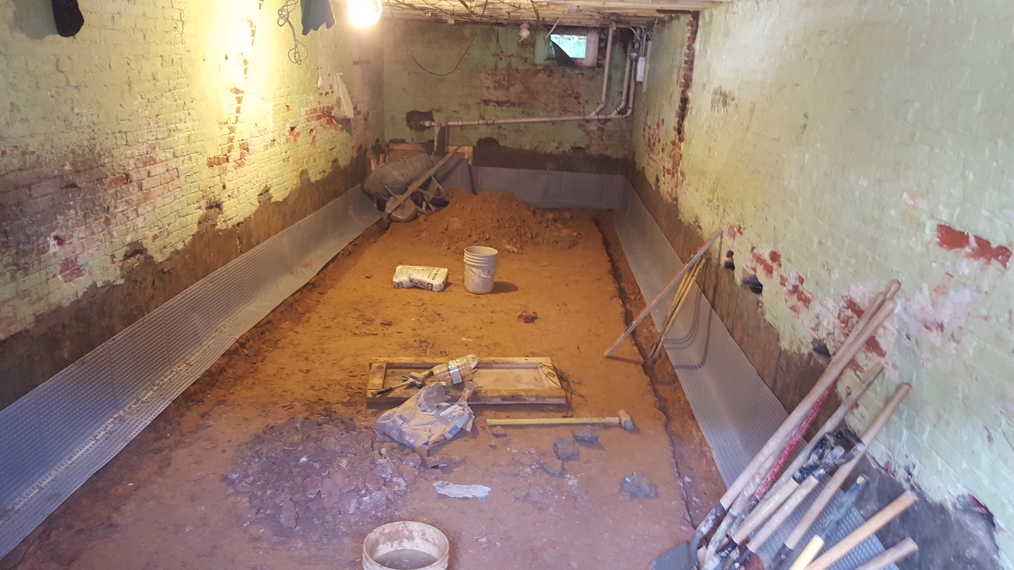 Digging Basements Adding New Height To Low Ceilings By Underpinning Potomac Real Estate And